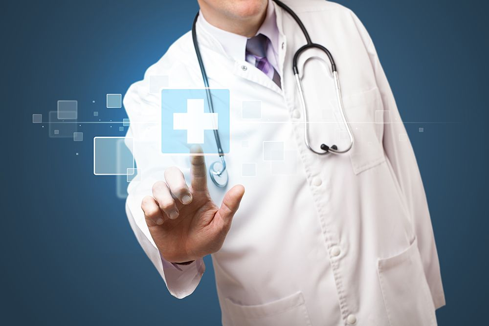 doctor using digital screen to asses medical issue